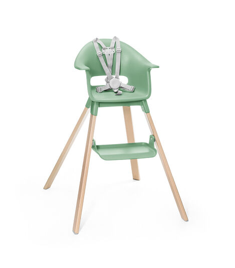 Stokke® Clikk™ High Chair. Natural Beech wood and Clover Green plastic parts. Stokke® Harness attached. Footrest high.