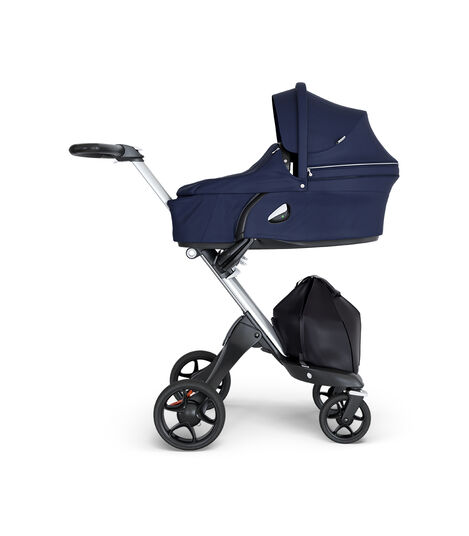 Stokke® Xplory® wtih Silver Chassis and Leatherette Black handle. Stokke® Stroller Carry Cot Deep Blue. view 2