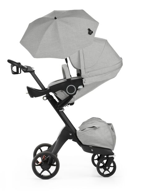 Stokke® Xplroy® With Black Chassis. Stokke® Stroller Seat and Parasol, Grey Melange. New wheels 2016.
