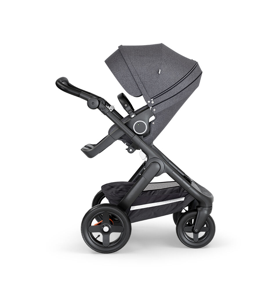 Stokke® Trailz™ with Black Chassis, Black Leatherette and Terrain Wheels. Stokke® Stroller Seat, Black Melange.