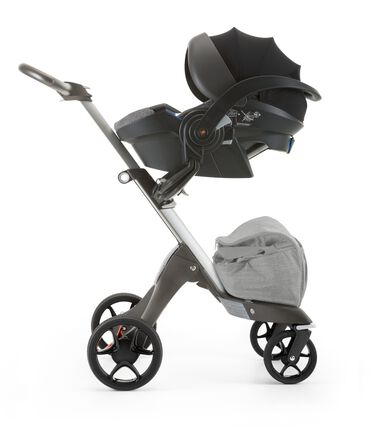 Stokke® iZi Go Modular™ by Besafe®, Black Melange. Mounted on Stokke® Xplory®.