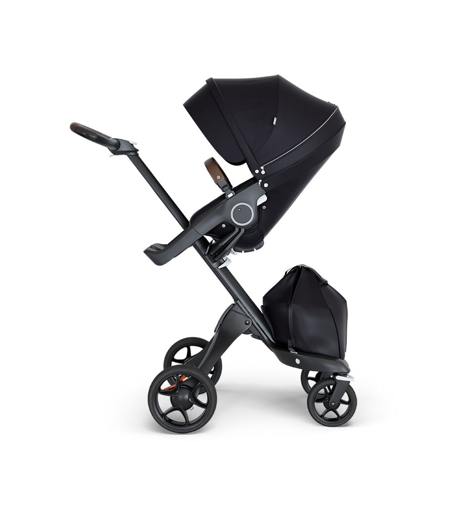 Stokke® Xplory® wtih Black Chassis and Leatherette Brown handle. Stokke® Stroller Seat Black.