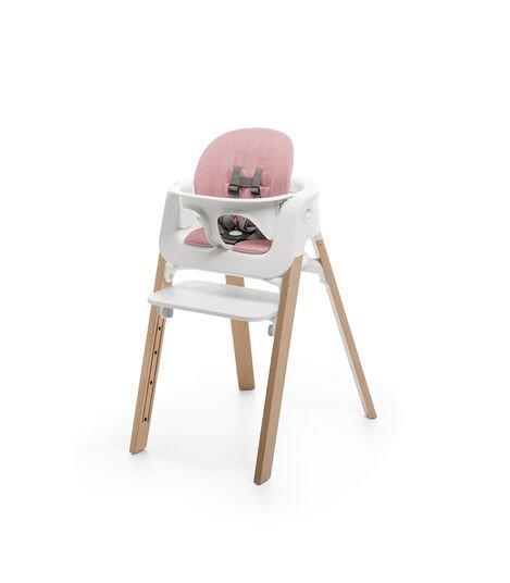 Stokke® Steps™ Natural with Baby Set and Pink Cushion.