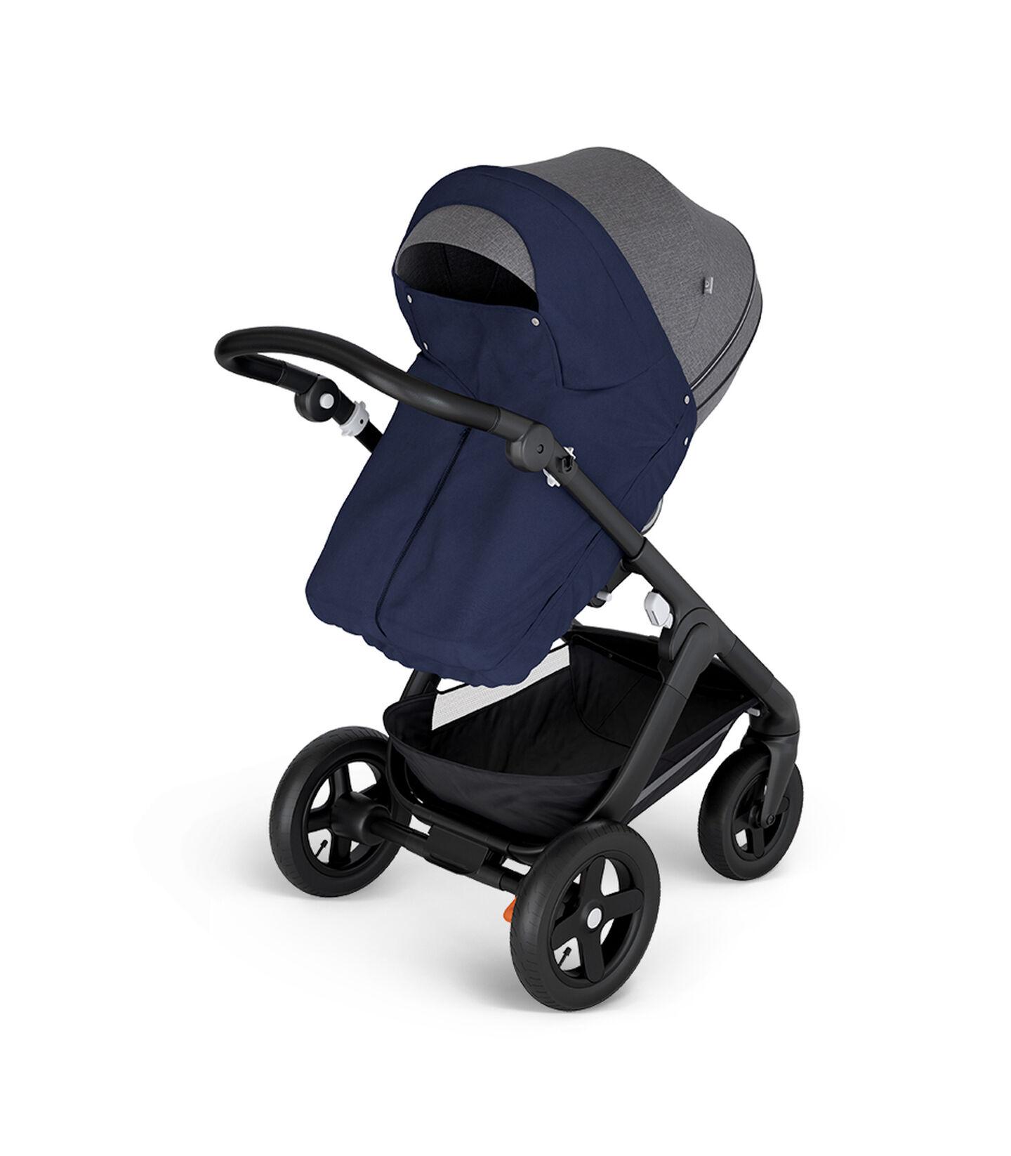 Stokke® Trailz™ with Black Chassis and Stokke® Stroller Seat Black Melange. Stokke® Stroller Storm Cover, Deep Blue.