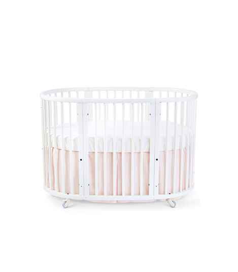 Stokke® Sleepi™ Bed, White. Bed Skirt Blush. US only.
