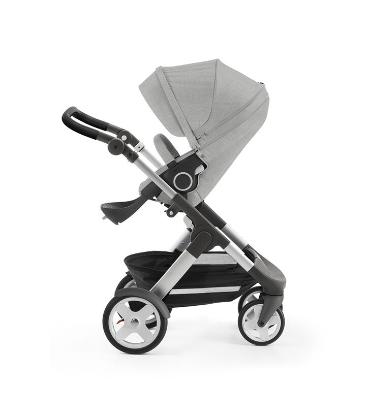 Stokke® Trailz™ with silver chassis and Stokke® Stroller Seat, Grey Melange. Classic Wheels. view 1