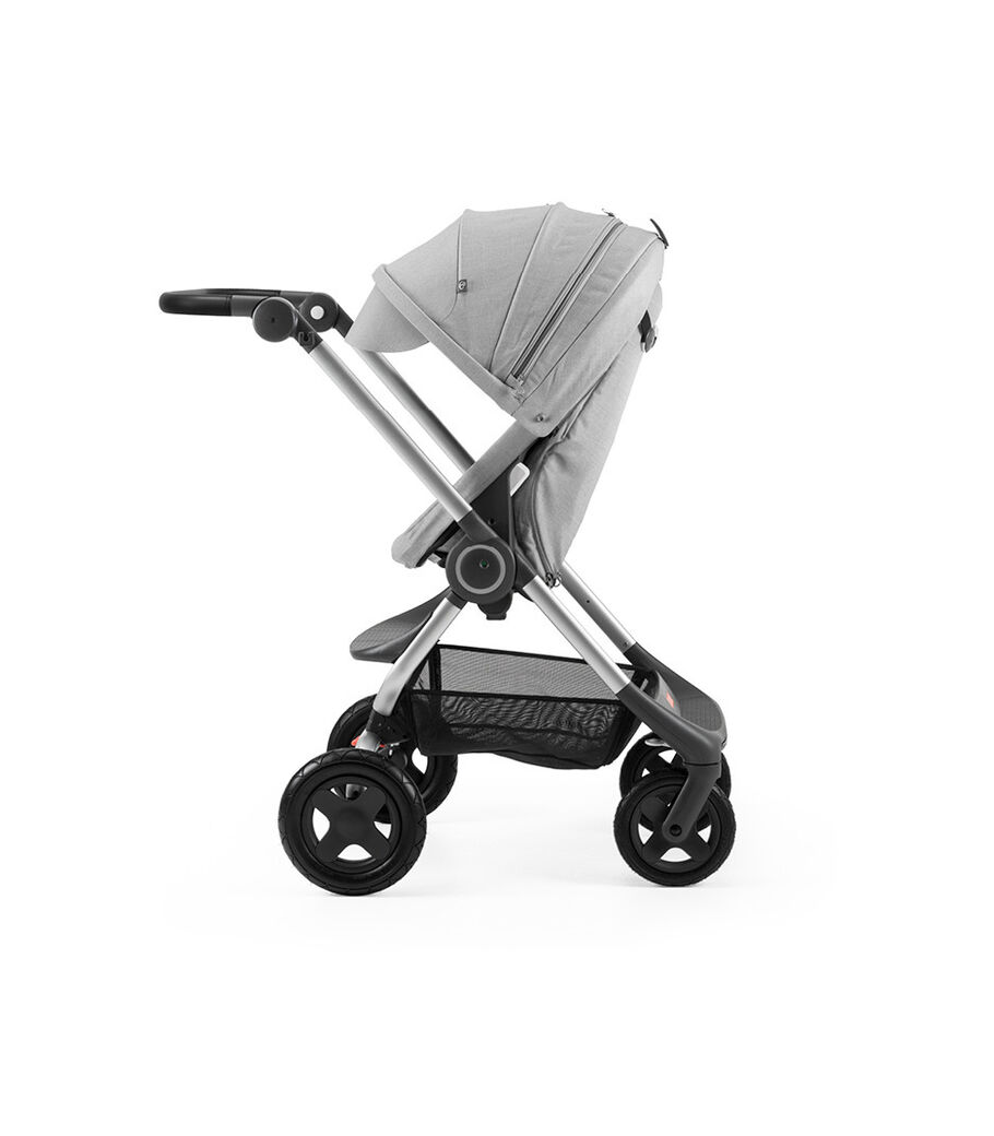 Stokke® Scoot™ Grey Melange with Grey Melange Canopy. Parent facing, active position.