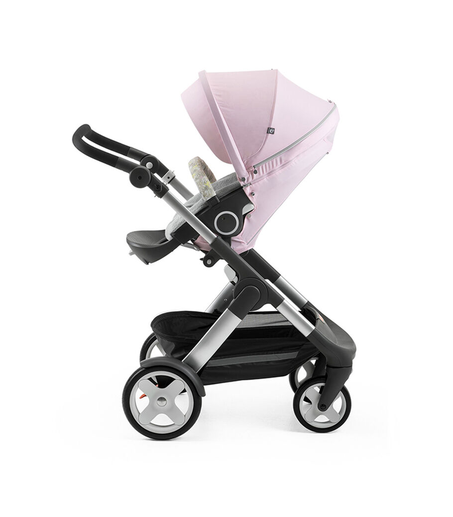 Stokke® Trailz™ with Stokke® Stroller Seat and Flora Pink Summer Kit.