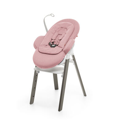 Stokke® Steps™ Hazy Grey with white Seat and footrest. Bouncer Pink.