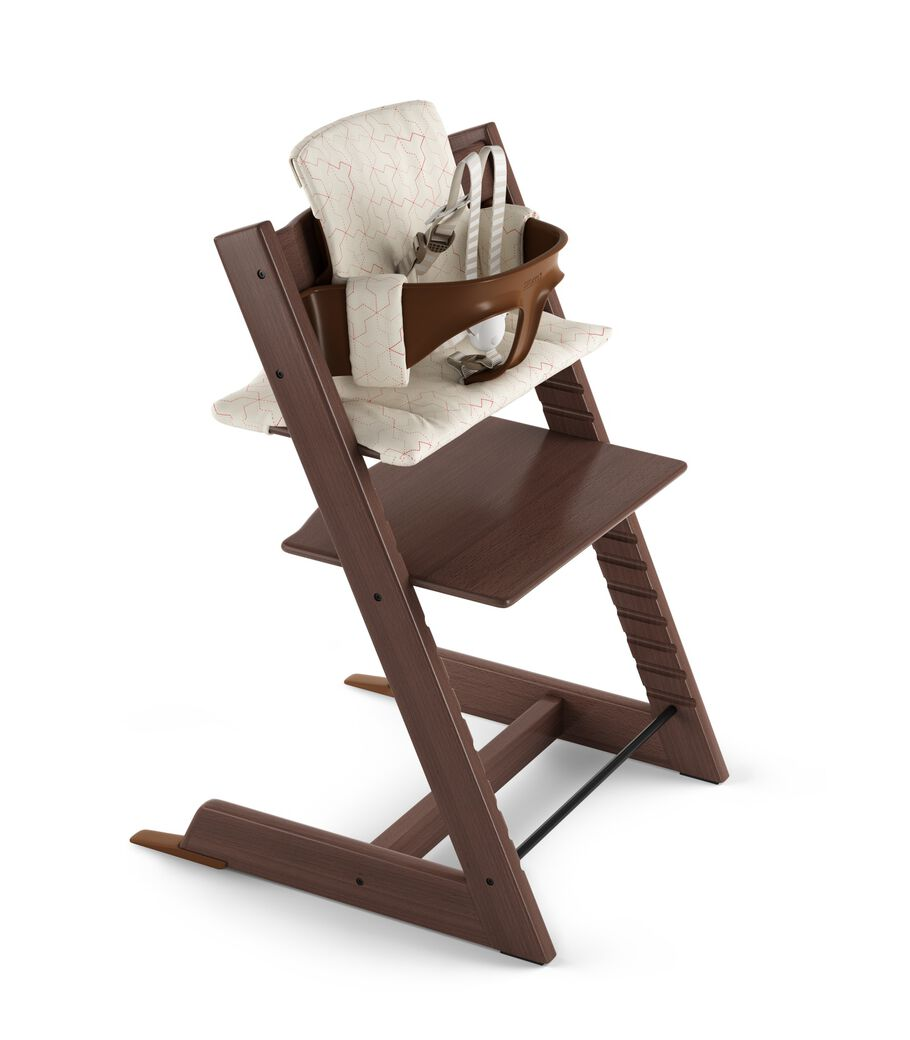 Tripp Trapp® Walnut Brown with Baby Set and Classic Cushion Geometric Red. US version.