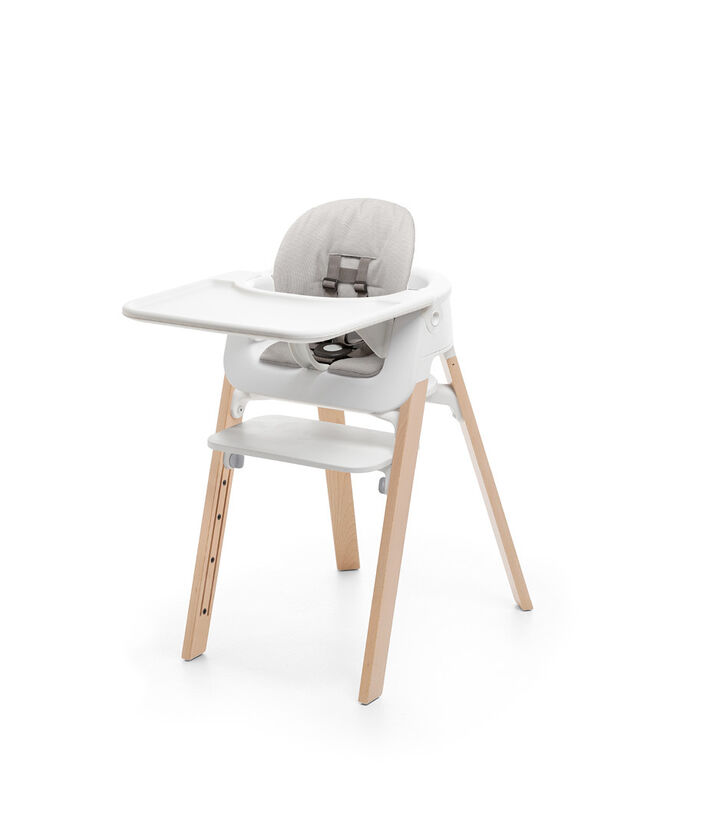 Stokke® Steps™ Chair Natural. Baby Set White. Cushion Timeless Grey. Baby Set Tray White.