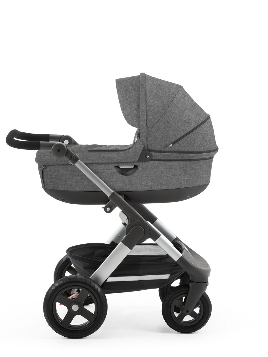 Stokke® Trailz™ with Stokke® Stroller Carry Cot Black Melange.