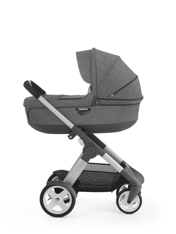 With Stokke® Stroller Carry Cot, Black Melange.