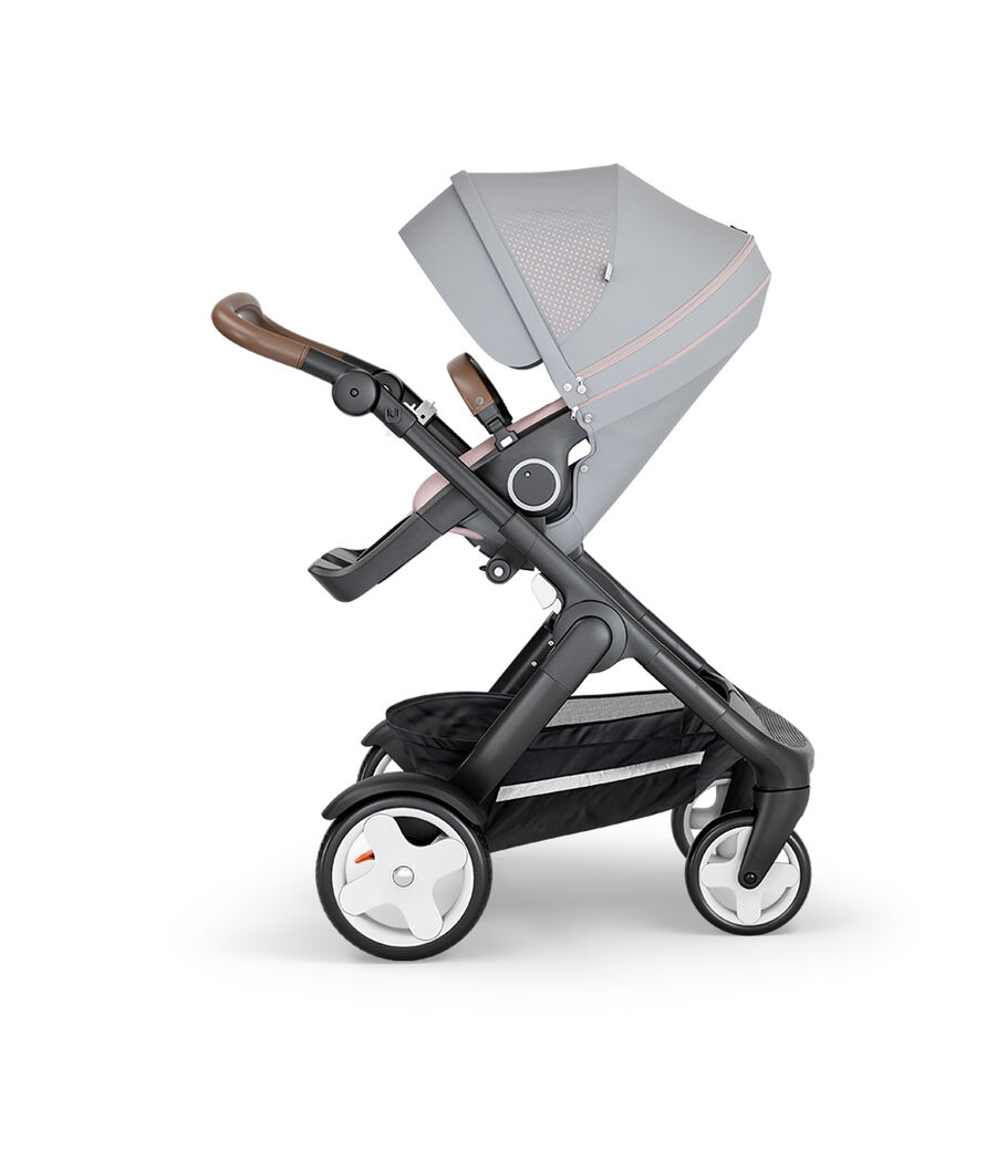 Stokke® Trailz™ with Black Chassis, Brown Leatherette and Classic Wheels. Stokke® Stroller Seat, Athleisure Pink.