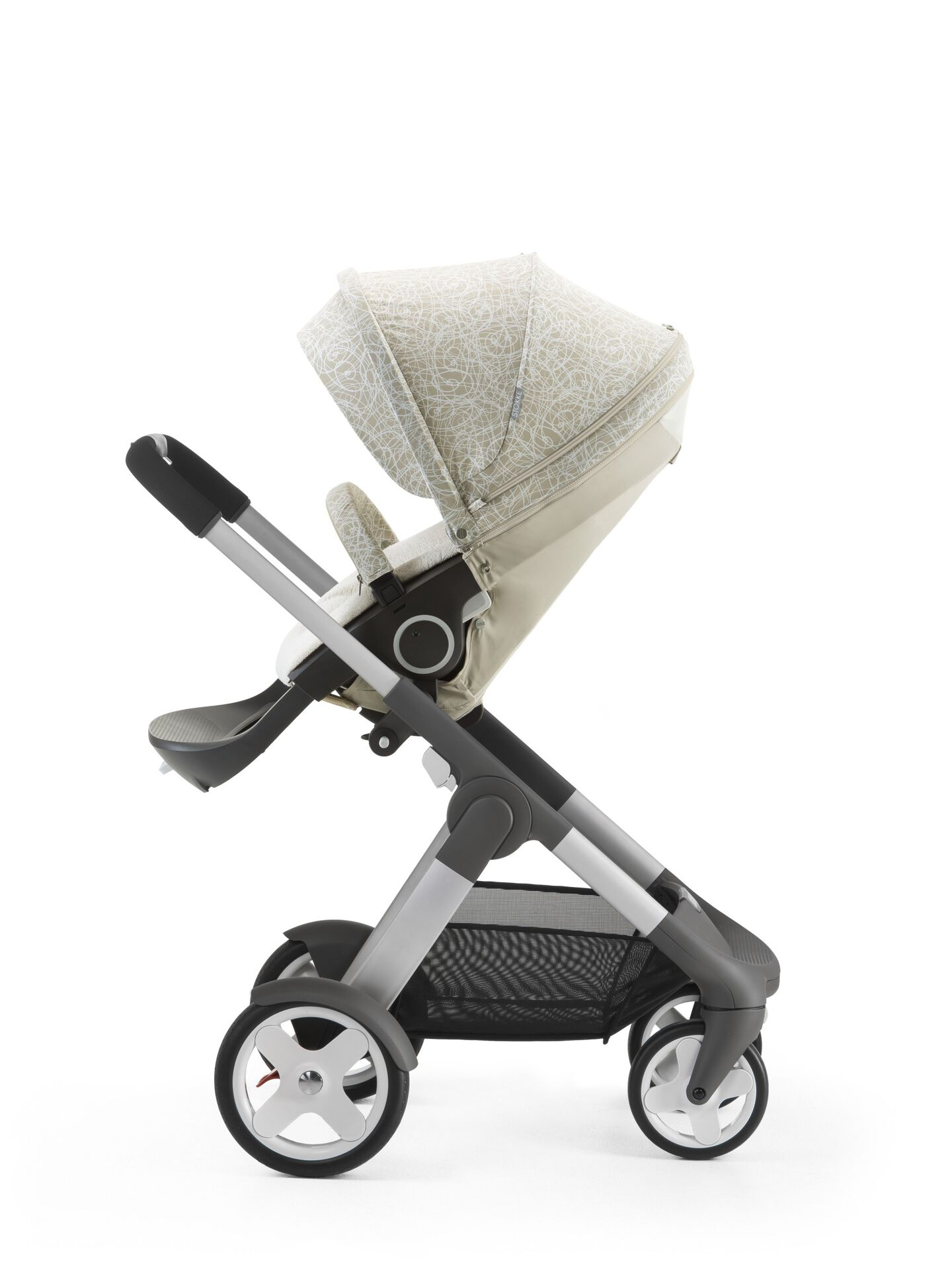 Stokke® Crusi™ with Stokke® Stroller Summer Kit Scribble Sandy Beige.