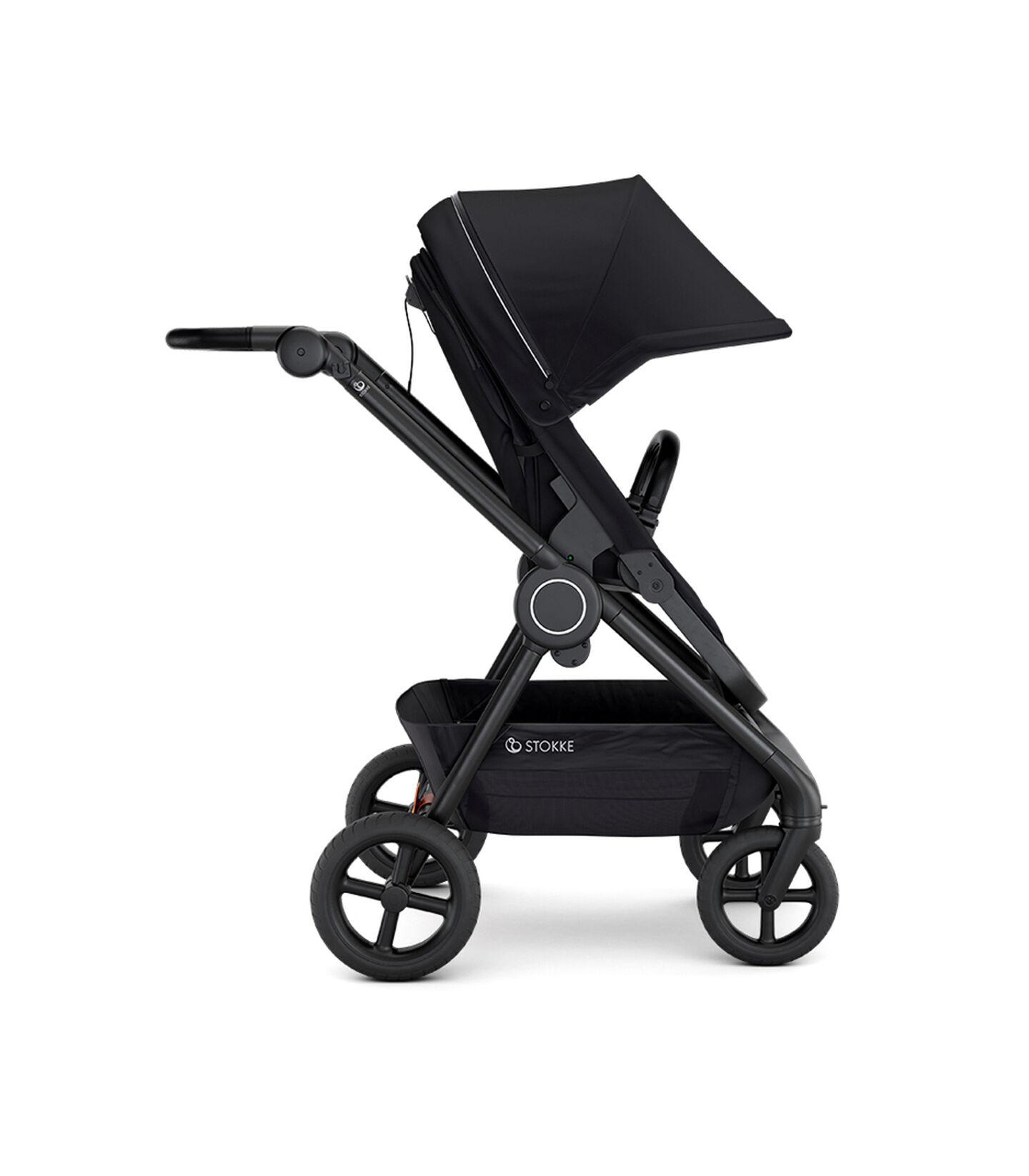 Stokke® Beat™ with Seat. Black. Forward facing.