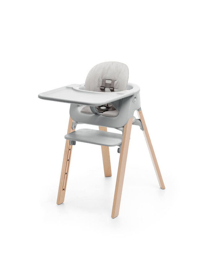 Stokke® Steps™ Natural with Accessories. Baby Set Light Grey. Baby Set Cushion Timeless Grey. Baby Set Tray Light Grey.