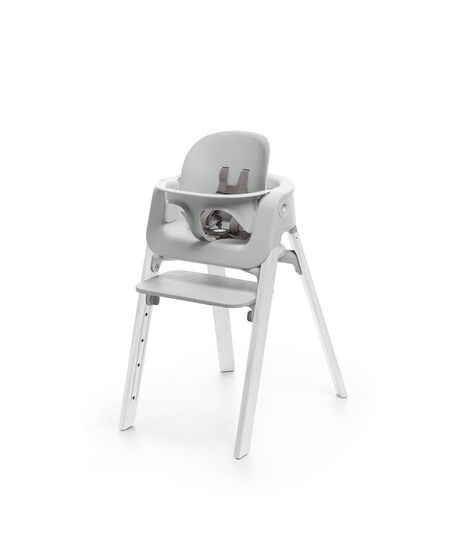 Stokke® Steps™ Oak White chair with Baby Set Light Grey.