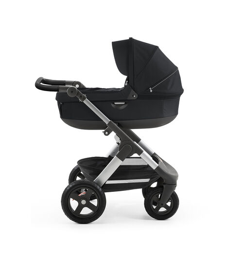 Stokke® Trailz™ with silver chassis  and Stokke® Stroller Carry Cot, Black. Leatherette Handle. view 3