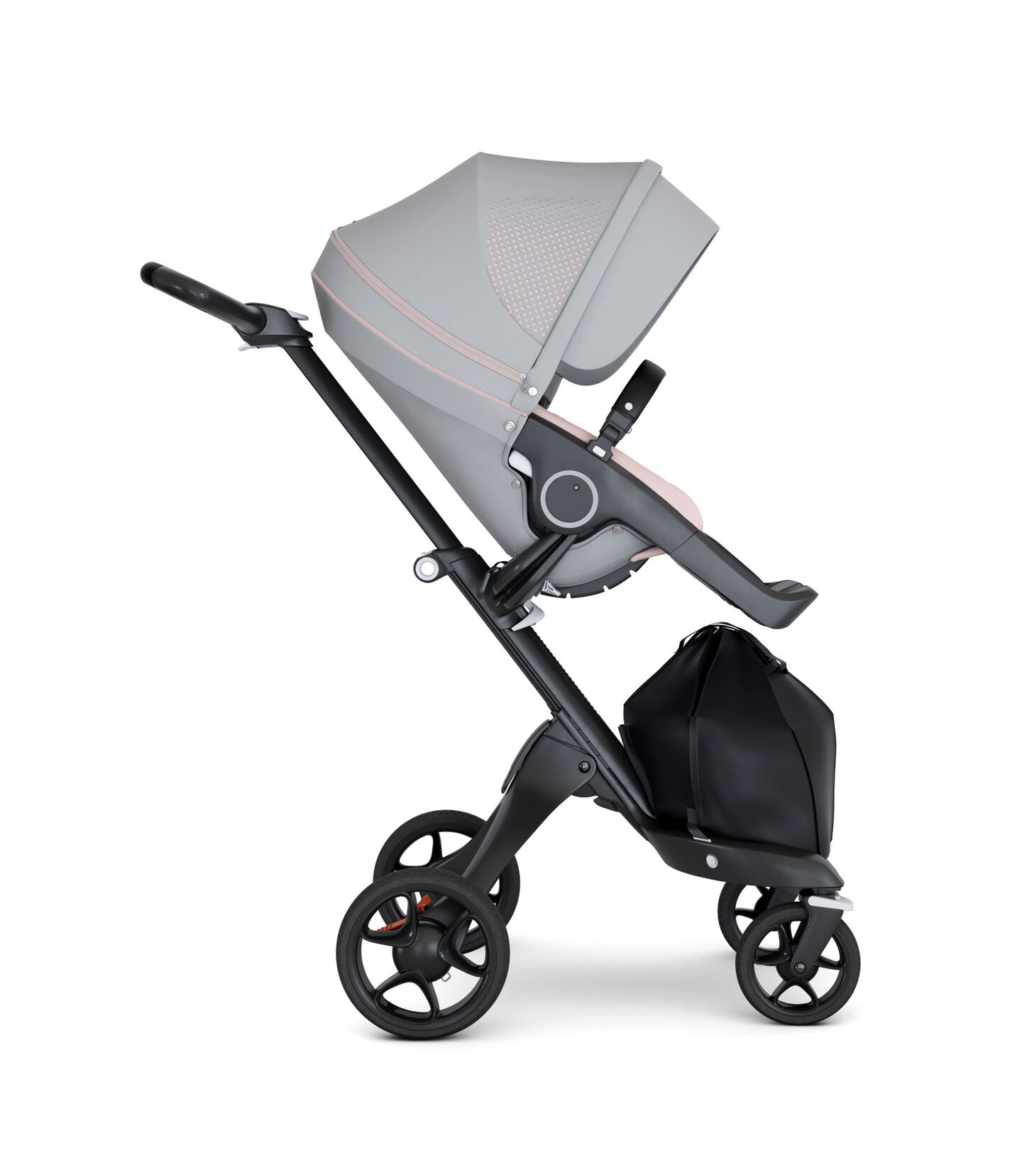 Stokke® Xplory® wtih Black Chassis and Leatherette Black handle. Stokke® Stroller Seat Seat Athleisure Pink. Forward facing.