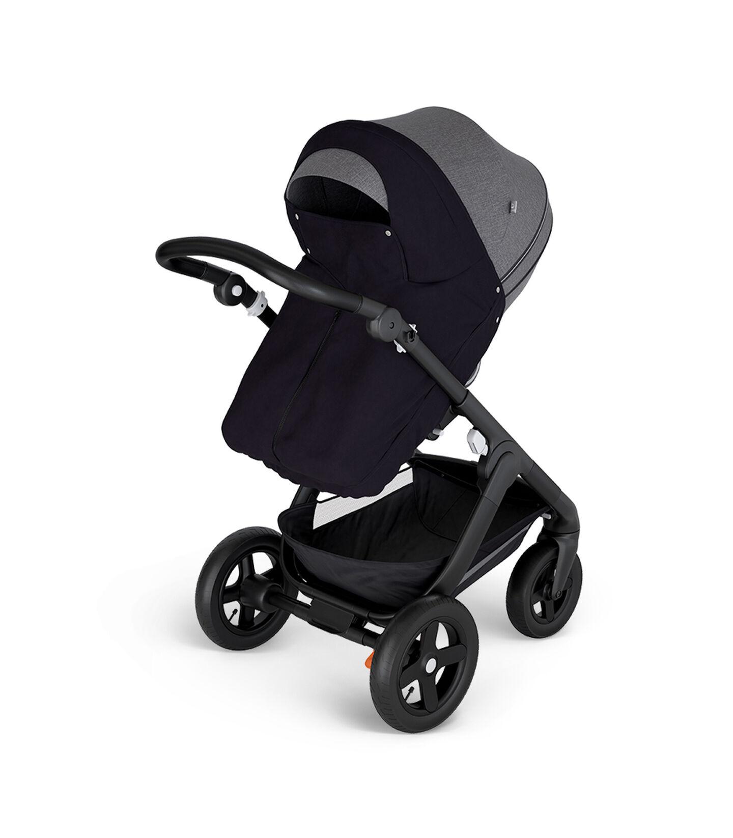 Stokke® Trailz™ with Black Chassis and Stokke® Stroller Seat Black Melange. Stokke® Stroller Storm Cover, Black.