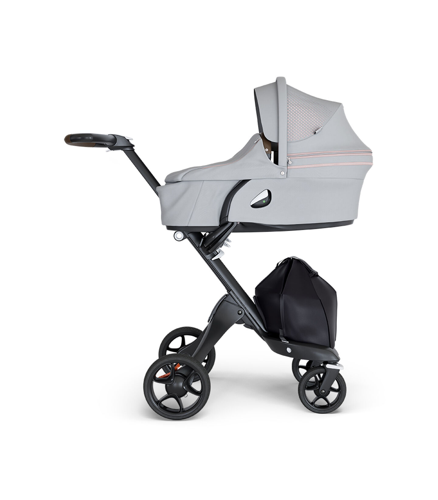 Stokke® Xplory® wtih Black Chassis and Leatherette Brown handle. Stokke® Stroller Carry Cot Athleisure Pink.
