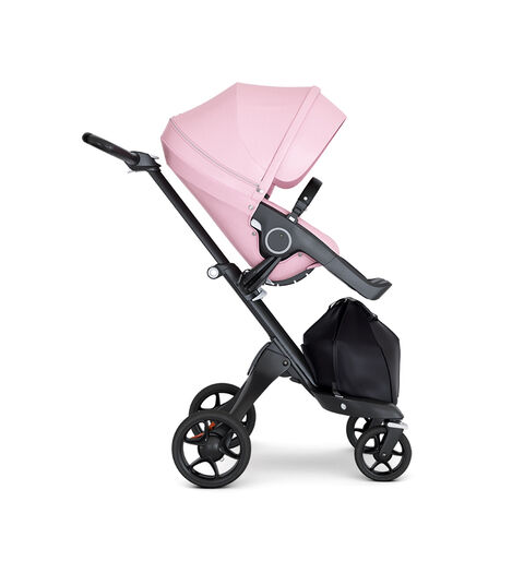 Stokke® Xplory® wtih Black Chassis and Leatherette Black handle. Stokke® Stroller Seat Seat Lotus Pink. Forward facing. view 2