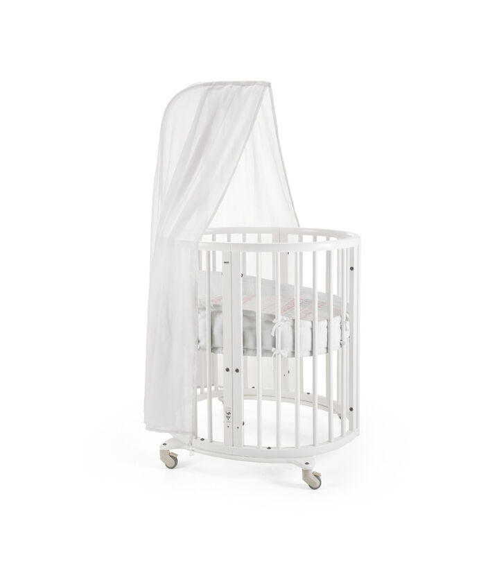 Stokke® Sleepi Mini, Natural. Canopy, Bumper and Fitted Sheet, Coral Straw. view 1