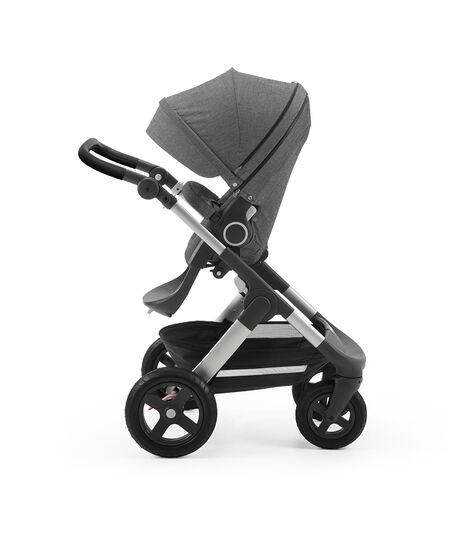 Stokke® Trailz with silver chassis and Stokke® Stroller Seat, parent facing, active position. Black Melange. Terrain wheels. Leatherette Handle. view 3