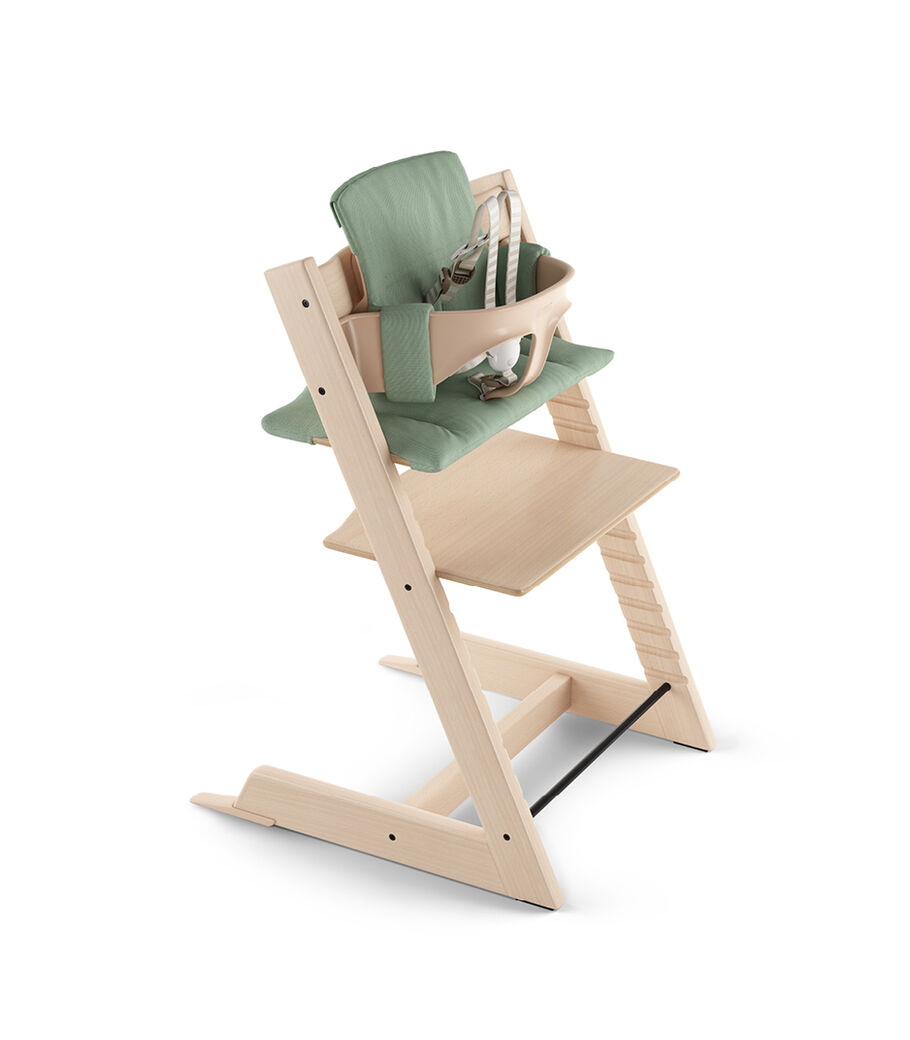 Tripp Trapp® Natural with Baby Set and Classic Cushion Timeless Green.