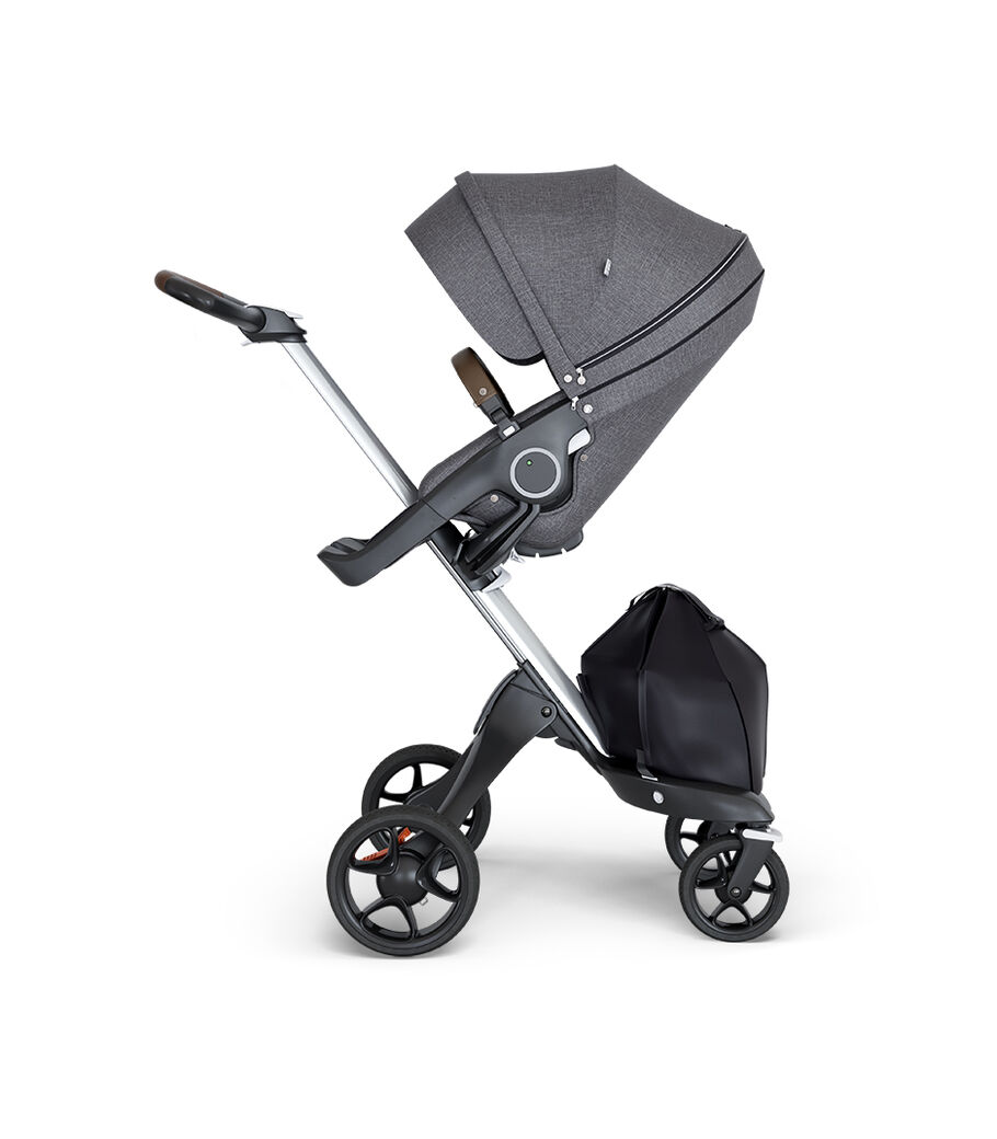 Stokke® Xplory® wtih Silver Chassis and Leatherette Brown handle. Stokke® Stroller Seat Black Melange.