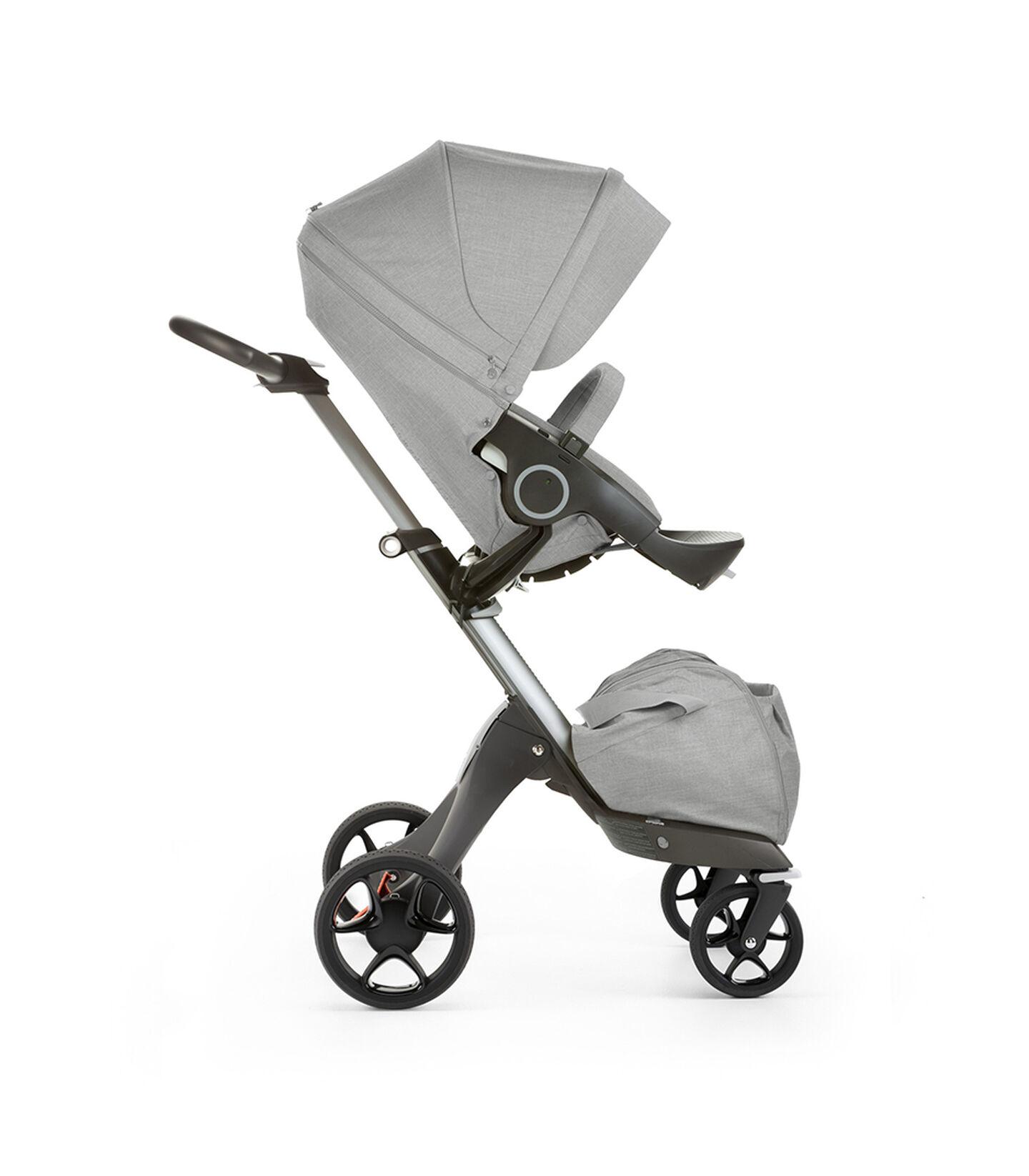 Stokke® Xplory® with Stokke® Stroller Seat, forward facing, rest position. Grey Melange. New wheels 2016.