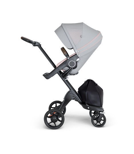 Stokke® Xplory® wtih Black Chassis and Leatherette Brown handle. Stokke® Stroller Seat Athleisure Pink. view 3