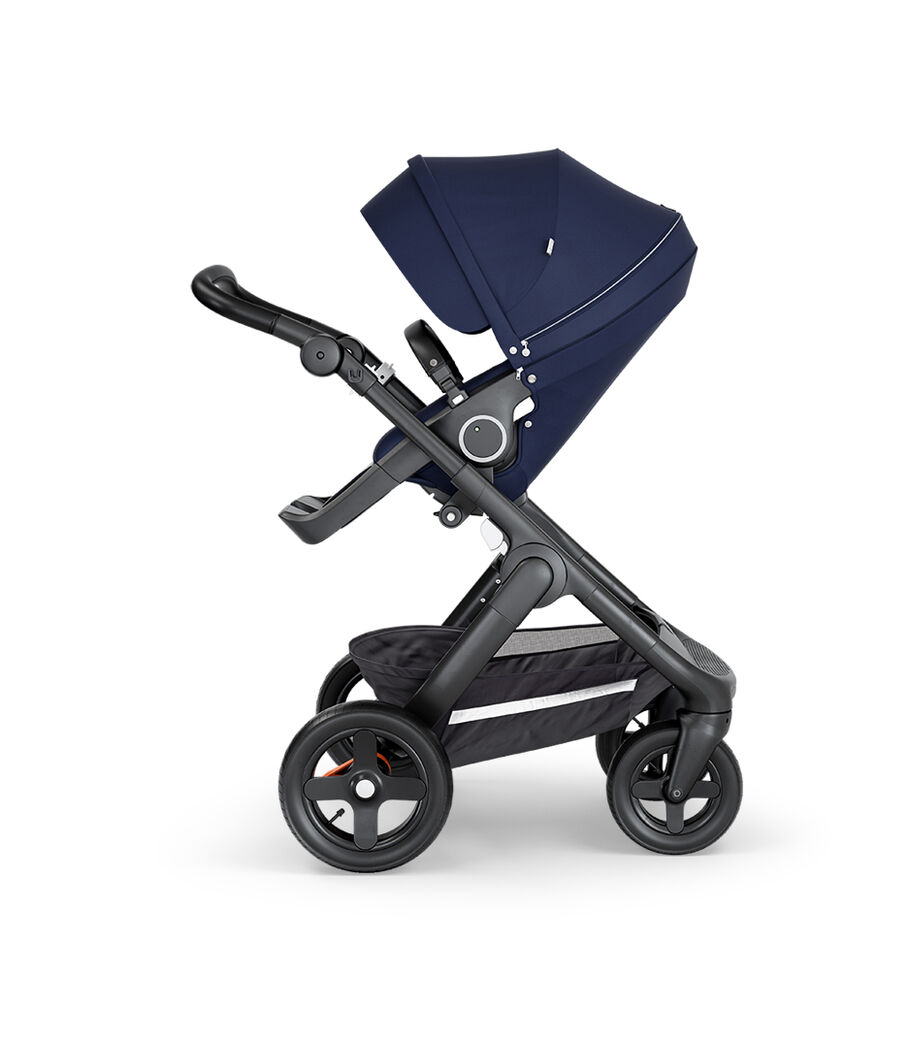 Stokke® Trailz™ with Black Chassis, Black Leatherette and Terrain Wheels. Stokke® Stroller Seat, Deep Blue.