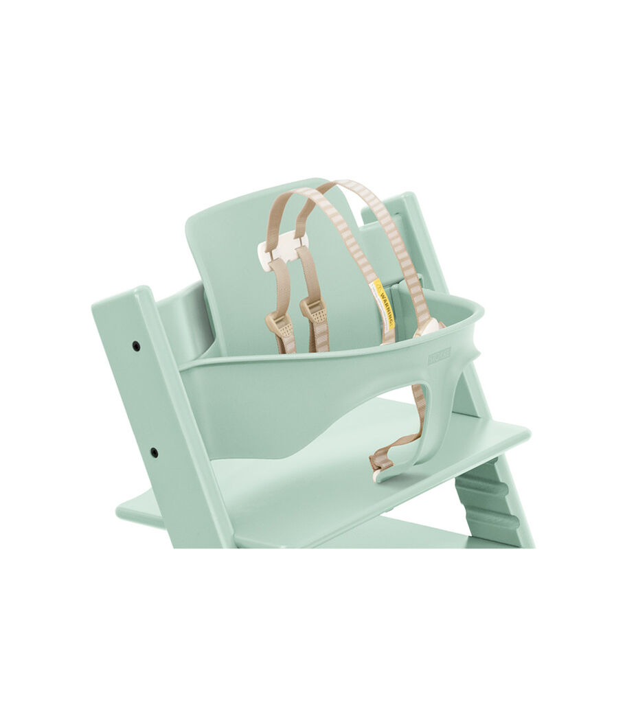 Tripp Trapp® Chair Soft Mint with Baby Set. Close-up. US with Harness. view 4