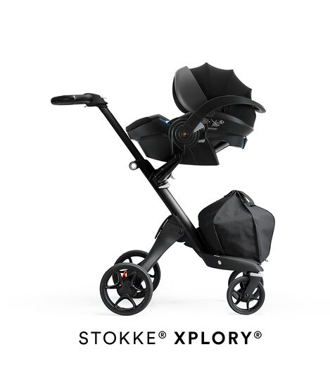 Stokke® iZi Go Modular™ X1 by Besafe®, Black. Mounted on Stokke® Xplory®.