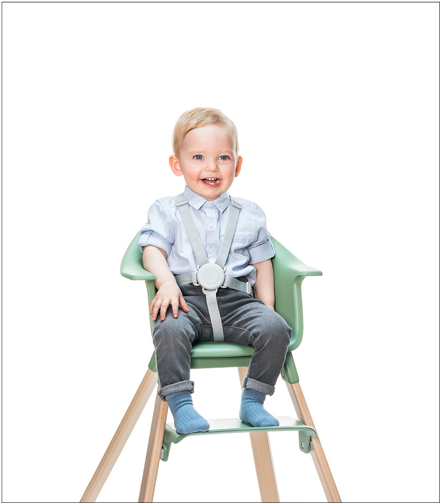 Stokke® Clikk™ High Chair. Natural Beech wood and Clover Green plastic parts. Harness.