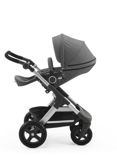 Stokke® Trailz™ with Stokke® Stroller Seat, parent facing, rest position. Black Melange. Terrain wheels.
