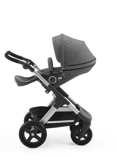 Stokke® Trailz™ with Stokke® Stroller Seat, parent facing, rest position. Black Melange. Terrain wheels.