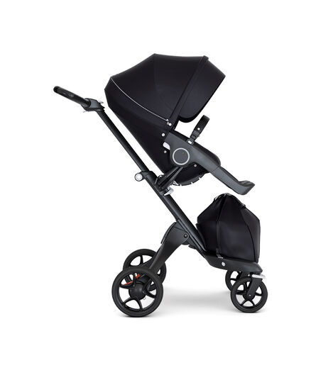 Stokke® Xplory® wtih Black Chassis and Leatherette Black handle. Stokke® Stroller Seat Seat Black. Forward facing.