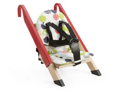 Portable child seat, Red, accessorised with Silhouette Green cushion.