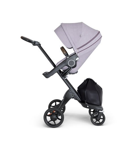 Stokke® Xplory® wtih Black Chassis and Leatherette Brown handle. Stokke® Stroller Seat Brushed Lilac.