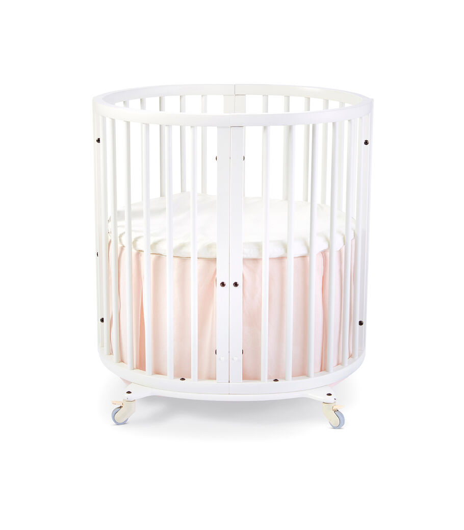 Stokke® Sleepi™ Mini, White. Bed Skirt Blush. US only.