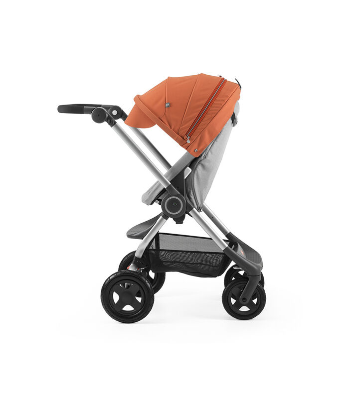 Stokke® Scoot™ Grey Melange with Orange Canopy. Parent facing, active position.