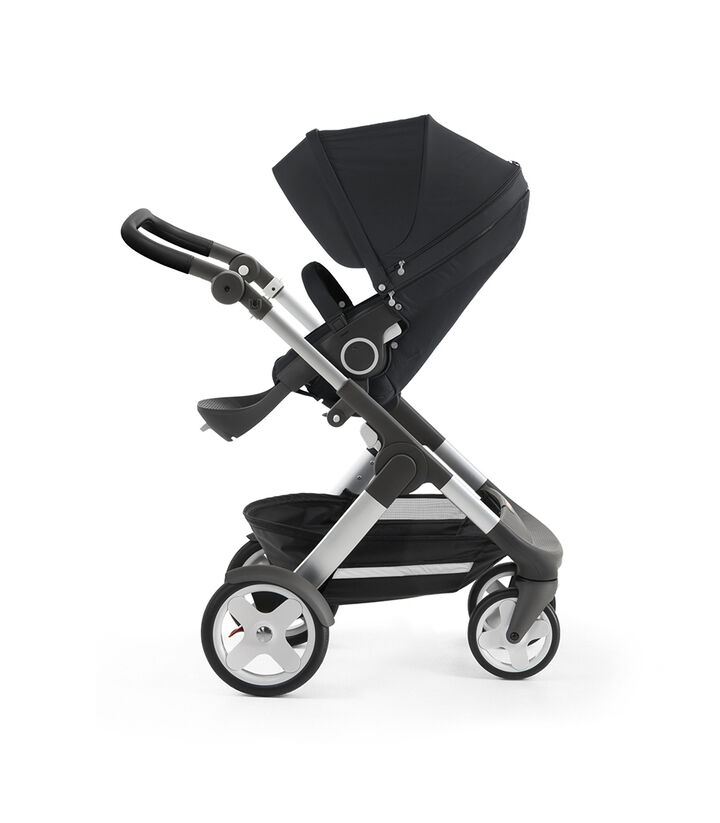 Stokke® Trailz™ with silver chassis and Stokke® Stroller Seat, Black Melange. Classic Wheels. view 1