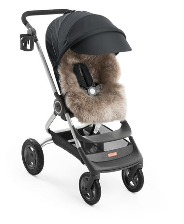 Stokke® Scoot™ Black, with Stokke® Sheepskin Lining, and Stokke® Stroller Cup Holder.