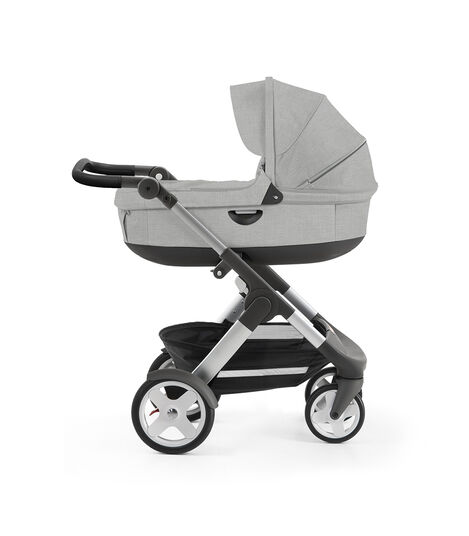 Stokke® Trailz™ with silver chassis and Stokke® Stroller Carry Cot, Grey Melange. Classic Wheels.