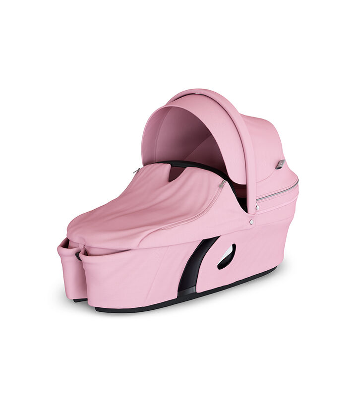 Stokke® Xplory® Carry Cot Lotus Pink. With Storm Cover. view 1