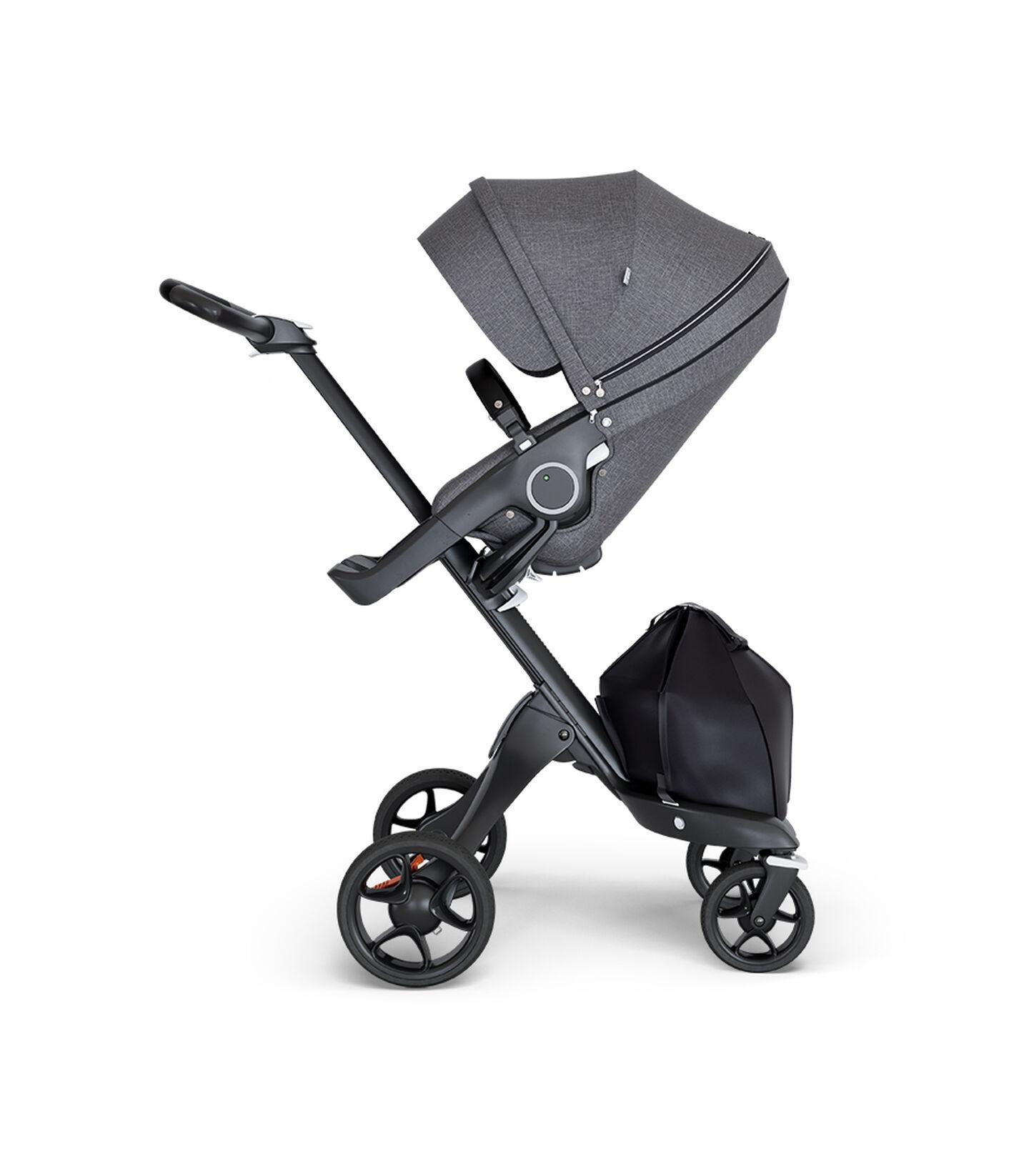 Stokke® Xplory® wtih Black Chassis and Leatherette Black handle. Stokke® Stroller Seat Black Melange.