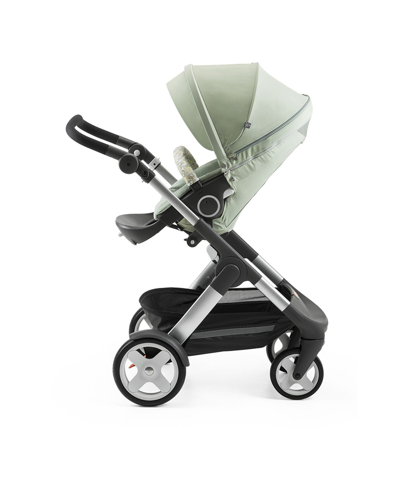 Stokke® Trailz™ with Stokke® Stroller Seat and Flora Green Summer Kit.